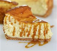 Eggnog Cheesecake with Caramel Rum Sauce